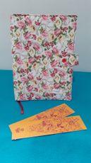 Capa protetora de livros em tecido florido