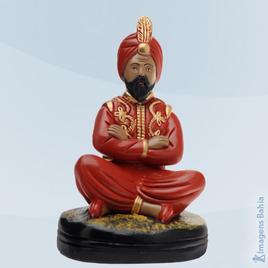 Imagem de Deus Hindu com bola e roupa vermelha